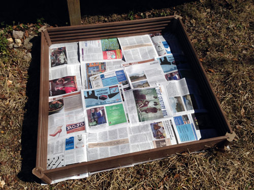 garden box with newspapers